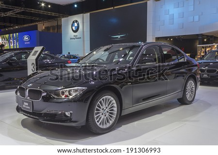 BANGKOK - APRIL 2: BMW 320i Luxury car on display at The 35th Bangkok International Motor Show on April 2, 2014 in Bangkok, Thailand.