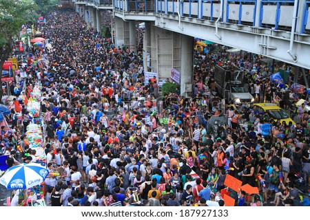 BANGKOK - APRIL 13: Crowd of people celebrating the traditional Songkran New Year Festival, April 13, 2014, Silom road, Bangkok, Thailand.