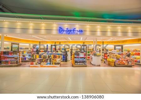 BANGKOK - APRIL 5: Duty free, Shopping area at Bangkok Suvarnabhumi International Airport on April 5, 2013 in Bangkok. The airport is 18th busiest in the world (by passenger traffic). - stock photo