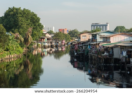 BANGKOK - APRIL 1, 2015: Houses around Lat Phrao canal. Houses encroaching on the canal are going to be demolished to make way for embankments along both sides of the canal to prevent flooding.