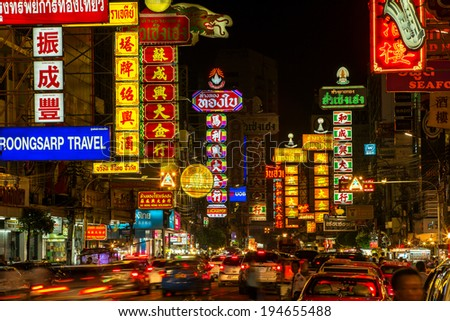 BANGKOK - APRIL 17: Neon shop signs at Yaowarat Road in the evening on April 17, 2014 in Bangkok. Yaowarat Road is a main street in Bangkok's Chinatown. - stock photo