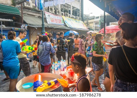 BANGKOK - APRIL 14,2014: Songkran Festival is celebrated in Thailand as the traditional New Year's Day from April 13 to 15 at Khao San Road by splashing water at each other, in Bangkok Thailand.