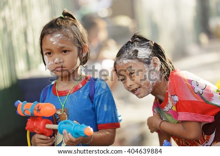 BANGKOK - APRIL 15 : Thai kids having fun with waterguns during the Songkran New Year Festival, April 15, 2011, Silom road, Bangkok, Thailand.