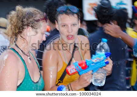 BANGKOK - APRIL 14: Thai peoples and travelers celebrate Songkran (new year / water festival: 13 April) by giving water  to each others on April 14, 2012 in Bangkok, Thailand. - stock photo