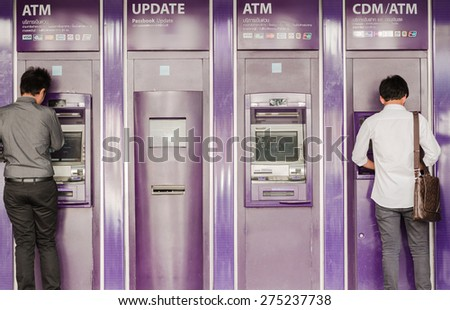 BANGKOK-APRIL,29 : The people are using purple Automatic Teller Machine of Saim commercial Bank on the side of main road on April 29,2015 in capital city Bangkok, Thailand  - stock photo