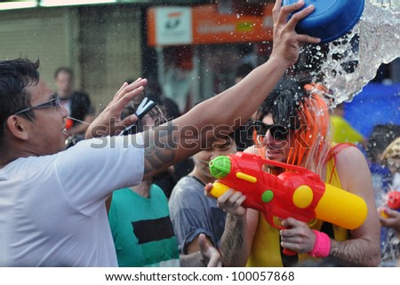 BANGKOK - APRIL 13: Unidentified revellers participates in a water fight on Khao San Road in celebrating the Thai new year on April 13, 2012 in Bangkok, Thailand.