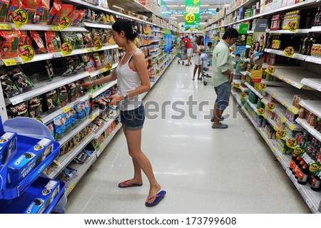 BANGKOK - APRIL 14: Unidentified shoppers browse an aisle of a Tesco supermarket on April 14, 2013 in Bangkok, Thailand. Tesco is the world's second largest retailer with a revenue of £65bn in 2012. - stock photo