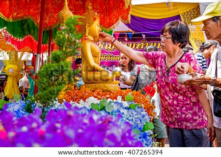 BANGKOK - APRIL 12, 2016 : unidentified Thai people and tourist joins celebrations of the Thai New Year or Songkran in Wat Pho, Thailand - stock photo