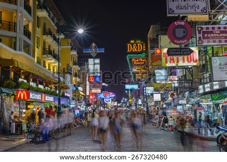 BANGKOK - April 6: Unidentified tourists walking at Khao San Road on April 6, 2015 in Bangkok, Thailand. This road is popular among backpacker because budget accommodation and food. - stock photo