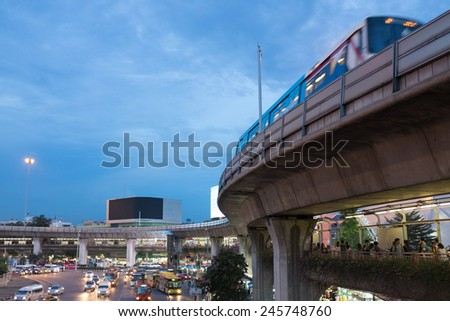 BANGKOK - AUG 23: A BTS Skytrain on elevated rails in Victory Monument on August 23 , 2014 in Bangkok, Thailand. The BTS system is a backbone public transportation in Bangkok. - stock photo