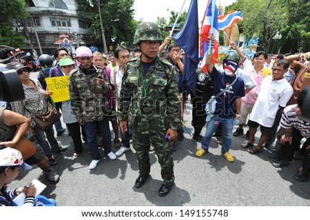BANGKOK - AUG 7: Activist Capt Songklod Chuenchupol waits for protesters to arrive at a rally near parliament on Aug 7, 2013 in Bangkok, Thailand. Bangkok is under tight security amid protests. - stock photo