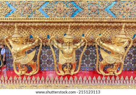 BANGKOK - AUG 2: Golden garuda sculptures at Temple of the Emerald Buddha Aug 2, 2014 in Bangkok, Thailand. The temple is regarded as the most sacred Buddhist temple (wat) in Thailand.