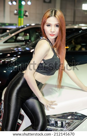 BANGKOK - AUGUST 16 :An unidentified female presenter models at Toyota Crown booth at Big Motor Sale 2014 on June 16,2014 in BITEC ,Bangkok, Thailand.