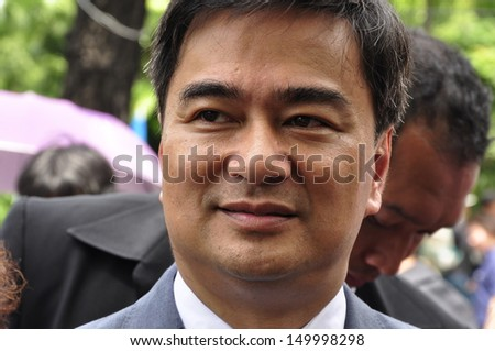BANGKOK - AUGUST 7, 2013: Former Prime Minister and current Democrat Party leader Abhisit Vejjajiva meets anti-government protesters during a demonstration, on August 7, 2013 in Bangkok.