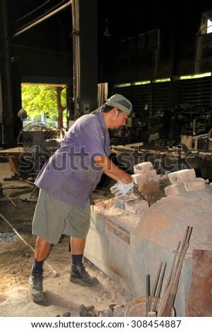BANGKOK - AUGUST 20 : Laborer is working at Makkasan workshop, the biggest railway repairing site of country on August 20, 2015 in Bangkok, Thailand.