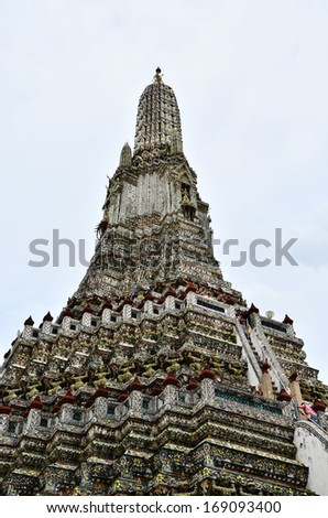 BANGKOK - 13 August 2013 : Wat Arun Ratchawararam or the Temple of Dawn. Thailand iconic decorated by ceramics and porcelains which was used as ballast by boats coming from China in King Rama III era.