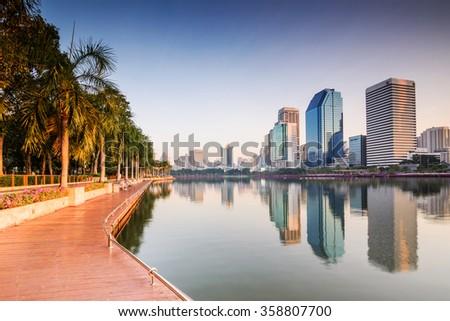 Bangkok Building with Reflection at sunrise, Benjakiti Park ,Thailand. - stock photo