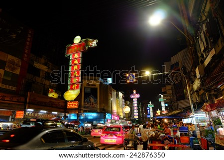 BANGKOK -: Busy Yaowarat Road in the evening on JULY 06, 2014 in Bangkok. Yaowarat Road is a main street in Bangkok's Chinatown, it was opened in 1891 in the reign of King Rama V. - stock photo