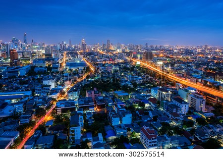 Bangkok city aerial view at twilight, business district with high building at dusk. - stock photo