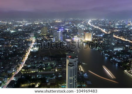 Bangkok city at twilight whit express way and cho pra-ya river, Thailand.
