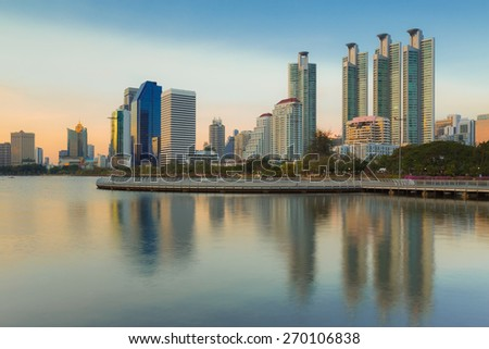 Bangkok city at twilight with reflection of skyline, Bangkok,Thailand - stock photo