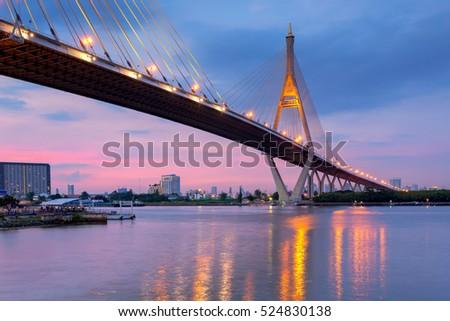 Bangkok City - Beautiful sunset view of Bhumibol Bridge in Bangkok , Bridge of transportation for import and export , the Bangkok ring industrial ,Bangkok ,Thailand