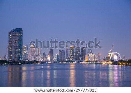 Bangkok city building at night.river in city.building and tall building in city.