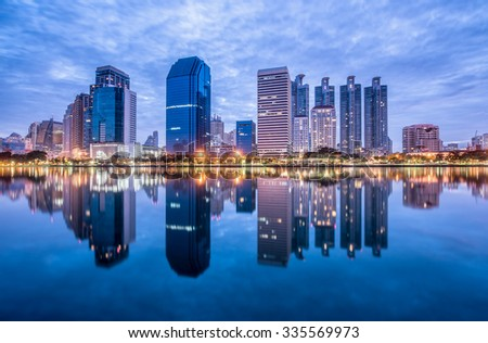 Bangkok city downtown at morning with reflection of skyline, Thailand