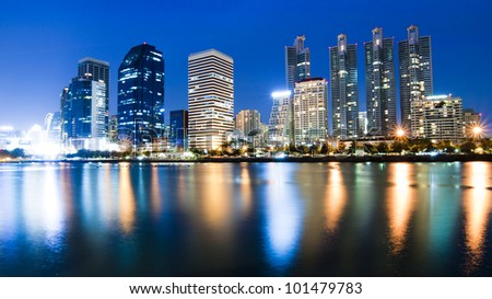 Bangkok city downtown at night with reflection of skyline, Bangkok,Thailand