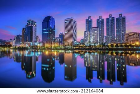 Bangkok city downtown at sunrise with reflection of skyline, Bangkok,Thailand - stock photo