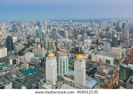 Bangkok City Manhattan street aerial view with skyscrapers, pedestrian and busy traffic. - stock photo