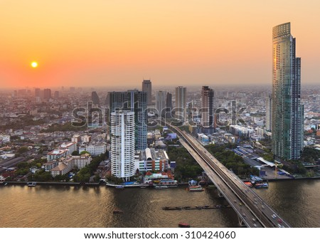 bangkok city riverside with high office building and condominium at sunset