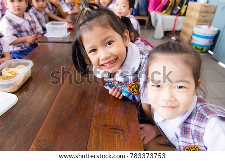 BANGKOK CITY, THAILAND - December 2016: December 29, 2016, Students are celebrating New Year in school. Children are happy.