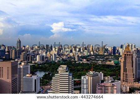 Bangkok City . Wonderful  Lumphini Park, Bangkok,  Panoramic and perspective wide angle view to steel light blue background of glass high rise building skyscraper commercial modern city of future. - stock photo