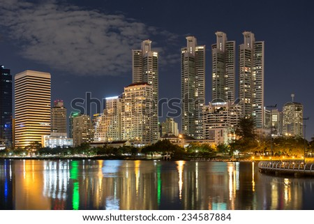 Bangkok cityscape at night with reflection of skyline ,Thailand - stock photo