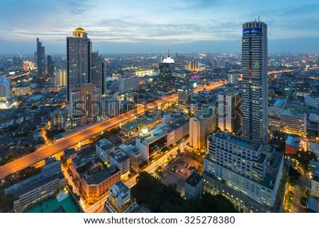Bangkok Cityscape, business district with expressway and highway at night , Bangkok, Thailand - stock photo