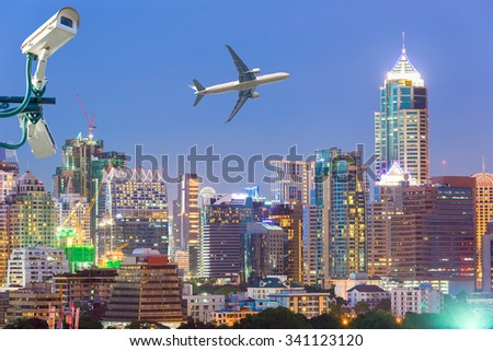 Bangkok Cityscape, Business district with high building, CCTV, airplane at dusk.