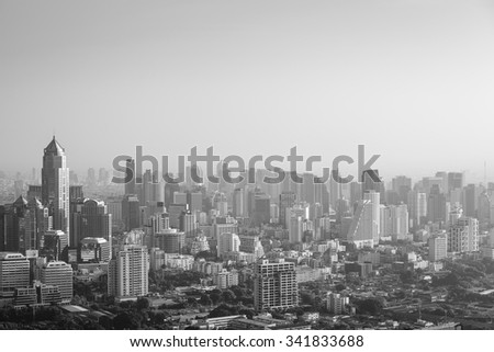 Bangkok cityscape in the morning, view from high building, sun is rising and mist is covering the city, black and white color - stock photo