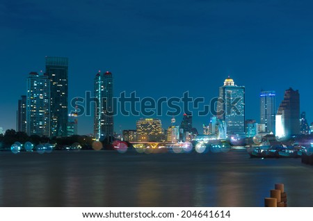 Bangkok cityscape river side at twilight time,Thailand - stock photo