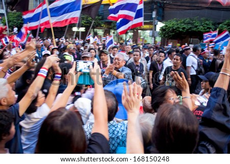 BANGKOK - DEC 20: A lot of people came to opposition march demanding resignation of government on Dec 20, 2013 in Bangkok, Thailand. The protesters want Yingluck Shinawatra Prime Minister to resign.