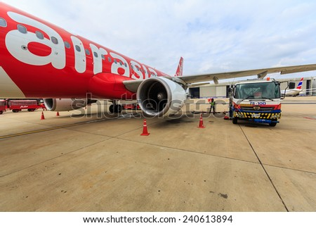BANGKOK - DEC 5: Air Asia at Don Mueang International Airport on Dec 5, 2014 in Bangkok. is a Malaysian low-cost airline headquartered near Kuala Lumpur, Malaysia. - stock photo
