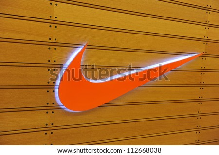 BANGKOK - DEC 27: Exterior of a sporting goods store displaying the Nike Swoosh logo on Dec 27, 2011 in Bangkok, Thailand. Forbes values Nike at $10.7B, making it the most valuable sports brand. - stock photo