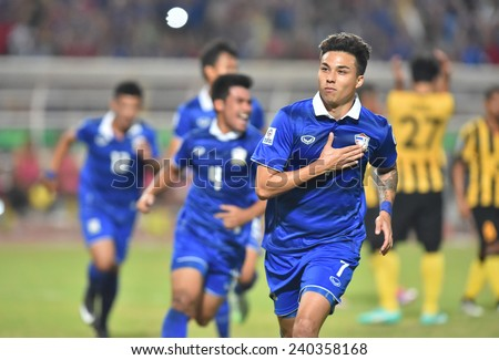 BANGKOK, DEC.17:Kroekrit Thawikan(B) of Thailand in action during the competition 2014 AFF Suzuki Cup between Thailand and Malaysia at Rajamangala stadium on December 17, 2014 in Bangkok, Thailand.