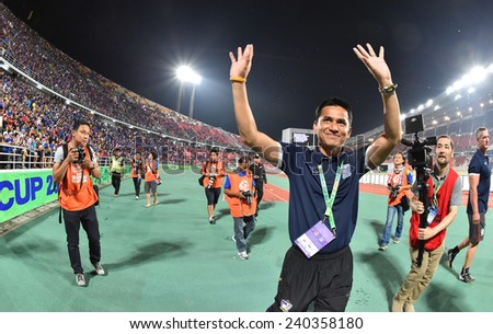 BANGKOK, DEC.17:Kroekrit Thawikan(B) of Thailand in action during the competition 2014 AFF Suzuki Cup between Thailand and Malaysia at Rajamangala stadium on December 17, 2014 in Bangkok, Thailand. - stock photo