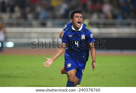 BANGKOK, DEC 10:Kroekrit Thawikan of Thailand celebrate the goal in competition 2014 AFF Suzuki Cup between Thailand and Philippines at Rajamangala stadium on December 10, 2014 in Bangkok, Thailand.  - stock photo