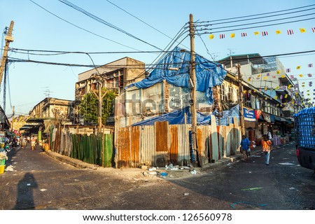 BANGKOK - DEC 23: old abandoned houses in Chinatown, Yaorwarat road on DEC 23,2009 in Bangkok,Thailand. In 1891 King Rama V ordered the construction of these roads and chinese people live there since. - stock photo