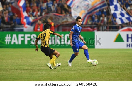 BANGKOK, DEC 17:Perapat Notechaiya(B) of Thailand in action during the competition 2014 AFF Suzuki Cup between Thailand and Malaysia at Rajamangala stadium on December 17, 2014 in Bangkok, Thailand.