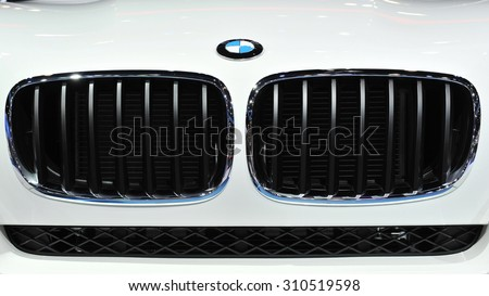 BANGKOK - DEC 11: View of a front grille of a BMW on Dec 11, 2011 in Bangkok, Thailand. Founded in 1916 BMW gas a global presence as a prestige car marque. - stock photo