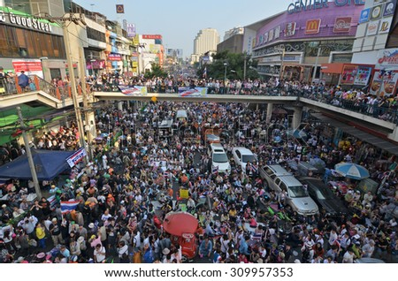 BANGKOK - December 22: Anti government nationalist protesters rally on a city centre street on December 22, 2013 in Bangkok, Thailand. The protesters call for the government to be overthrown.