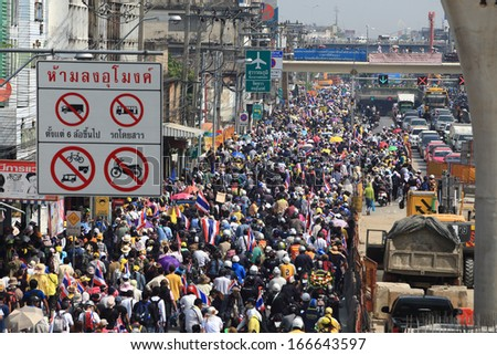 BANGKOK-DECEMBER 9 :Anti-government protesters rally outside Government House on DECEMBER 9 , 2013 in Bangkok, Thailand. The movement is known as the People's Democratic Force to Overthrow Thaksinism